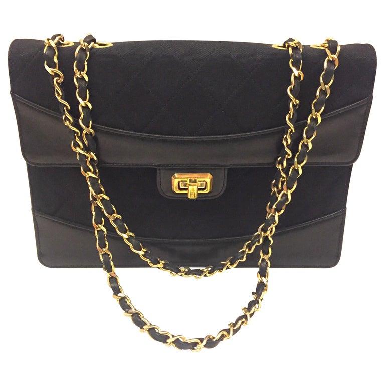 Chanel black canvas/leather shoulder bag  For Sale