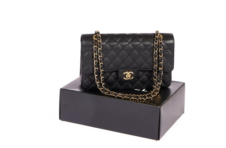 This classic Chanel Caviar double flap comes in black with the golden chain and the double CC logo in front. It's the perfect cross body bag and made for every occasion. This bag comes with a Chanel box, the booklet and inventory card. The hologram