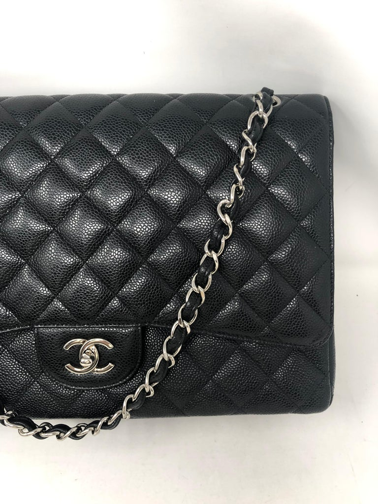 Chanel Black Caviar Leather Maxi Double Flap Bag. Silver hardware. Mint condition. Like new. 13