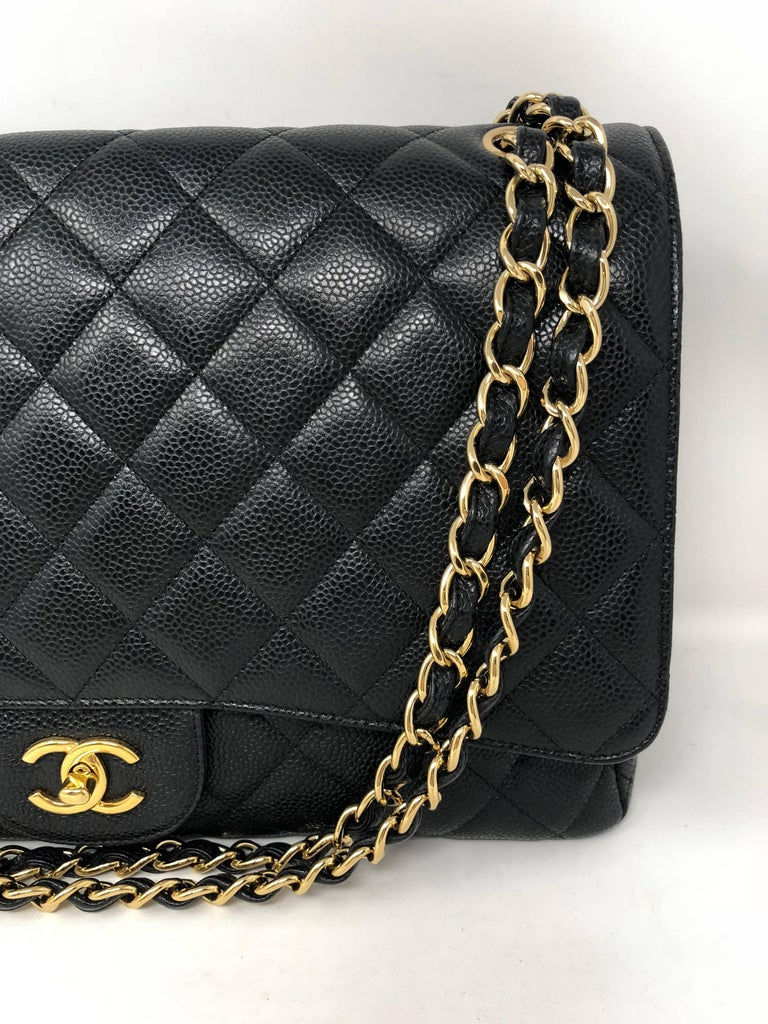 Chanel Black Caviar Leather Maxi Single Flap Bag with gold hardware. Mint condition wih slight wear. Bag can be worn doubled strap or as a crossbody.