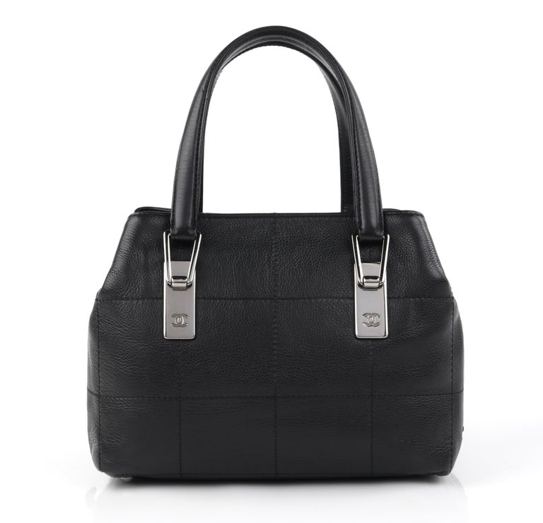 CHANEL Black Caviar Leather Silver Top Handle Quilted Satchel Handbag Purse  Brand / Manufacturer: Chanel Style: Top Handle Bag  Color(s): Black Unmarked Materials (feel of): Leather  Additional Details / Inclusions: Caviar square quilted stitched