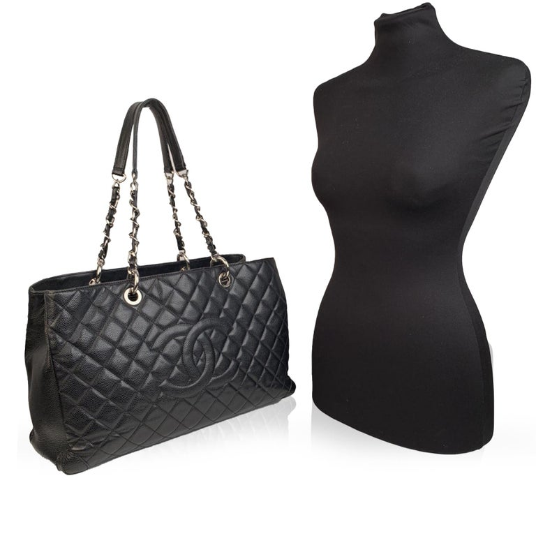 We offer Certificate of Authenticity provided by Entrupy for this item at no further cost.  Stunning CHANEL Caviar Grand Shopping Tote 'GST' . Quilted caviar leather in black color. Big CHANEL CC logo on the front. Silver hardware. Two interwoven