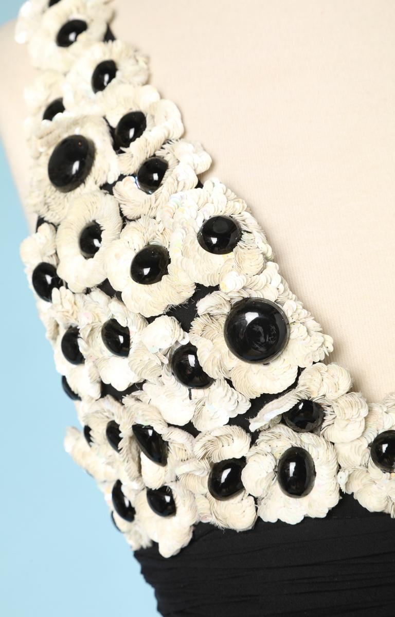 Black chiffon dress, top in black and white sequined flowers, with a flounce on the hips. Branded Chanel