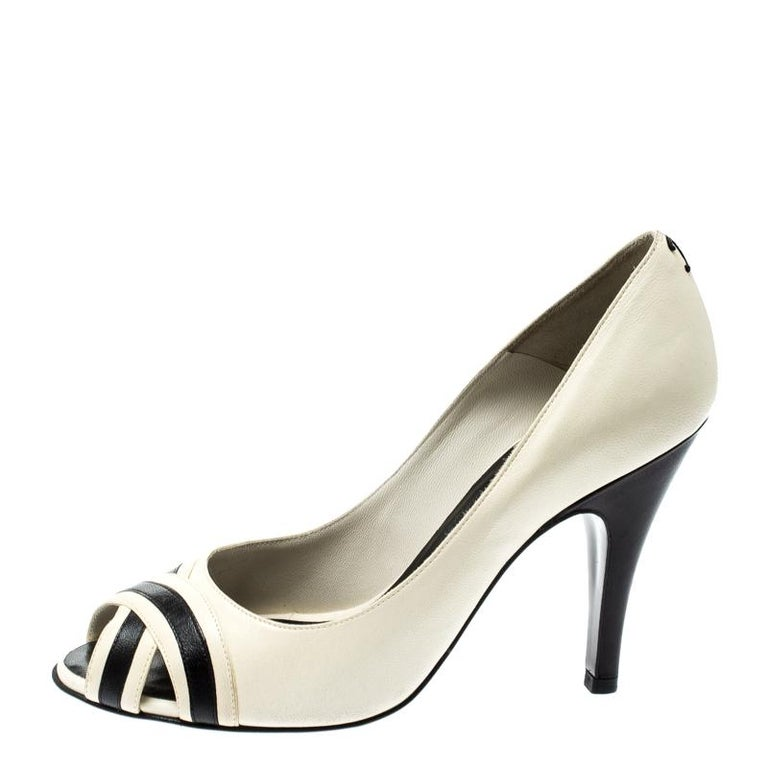 In a magical blend of luxury and elegance, these pumps come crafted from cream leather and designed with peep toes and crisscross design at the vamps. The CC logo on the counters and stiletto heels add the perfect finishing touch to the