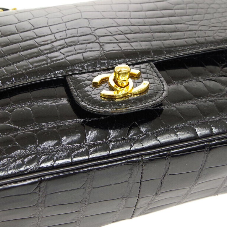 Chanel Black Crocodile Exotic Leather Gold Double Evening Shoulder Flap Bag  Crocodile Leather Gold tone hardware Leather lining Date code present Made in France Shoulder strap 15.5