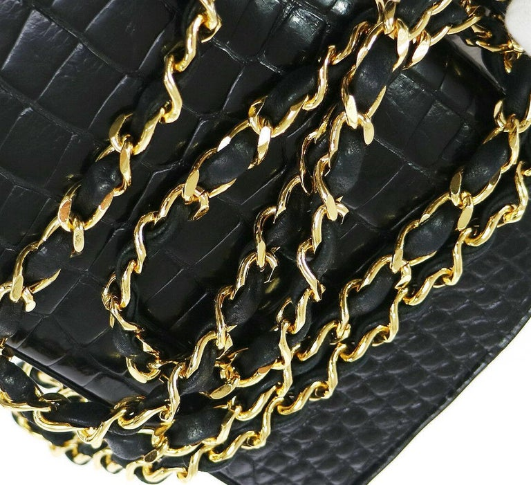 Chanel Rare Black Crocodile Leather Gold Evening Clutch Small Shoulder Flap Bag  Crocodile Leather Gold tone hardware Leather lining Made in France Date code present  Measures 7.5