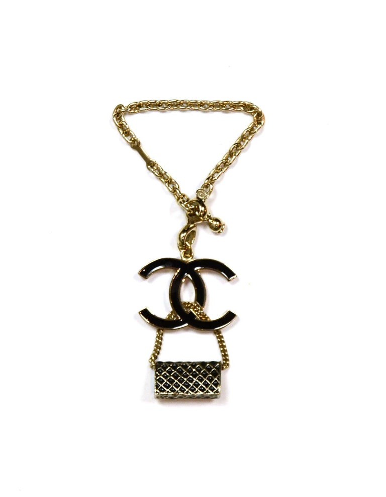 Chanel Black Enamel Goldtone CC & Flap Bag Keychain Bag Charm  Made In: Italy Year of Production: 2007 Color: Light goldtone, Black Materials: Enamel, Metal Hallmarks: