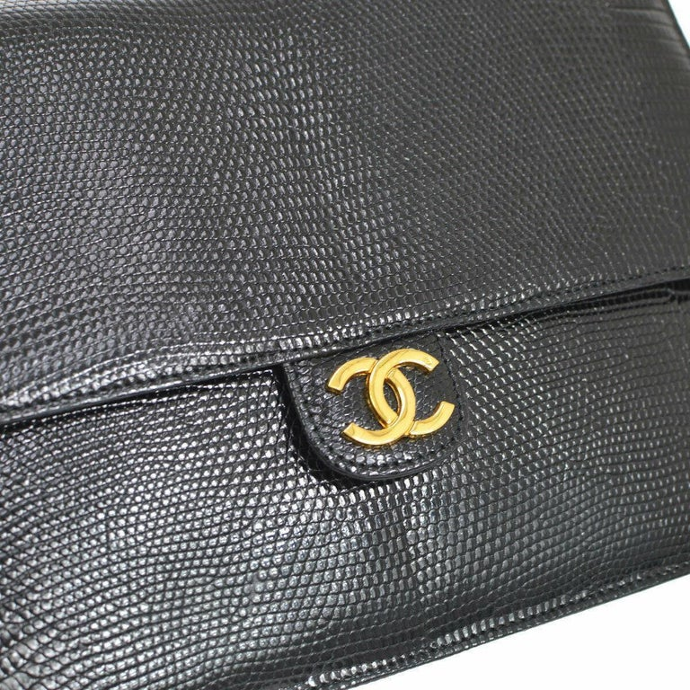 Chanel Black Exotic Lizard Leather Gold Evening Small Shoulder Flap Bag  Lizard Leather Leather lining Gold tone hardware Measures 9.5