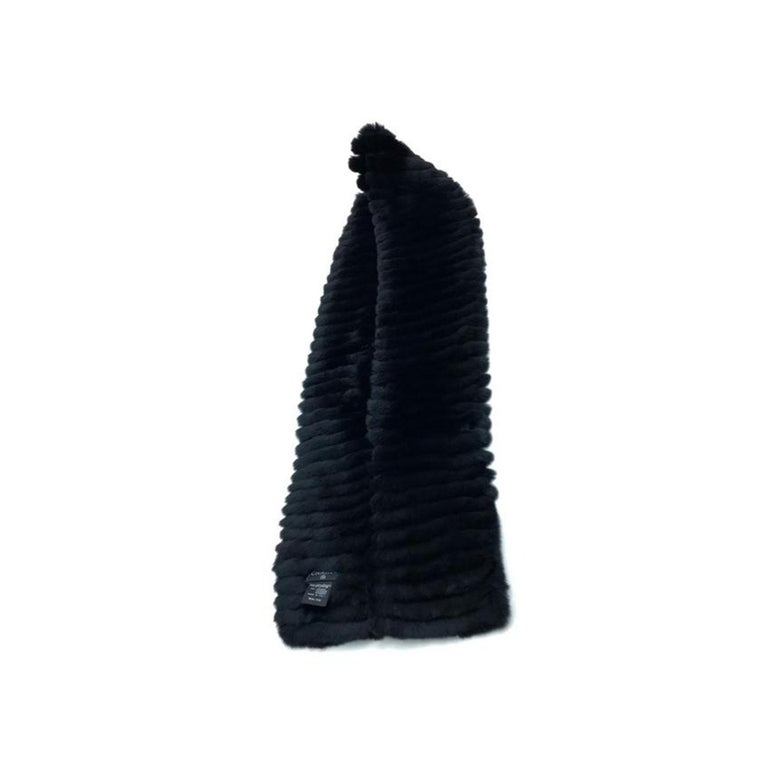 Chanel Black Fur Logo CC Long Neck Scarf  Year: 2014  Chanel Orylag Fur Cashmere Limited Edition Black  Soft Scarf Two tone CC fur logo accent on end 70% Orylag Fur 30% Cashmere  Made in Italy