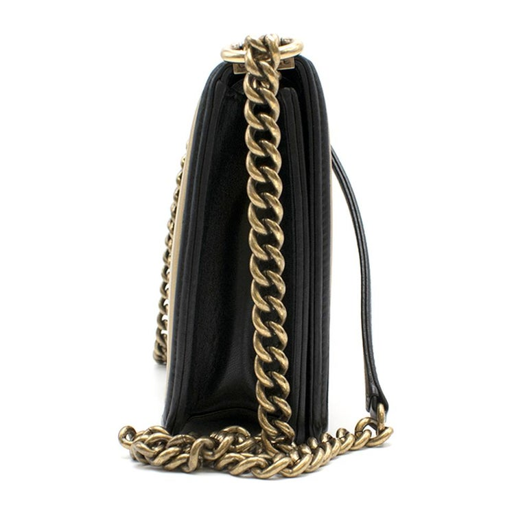 Chanel Black and Gold Leather Medium Boy Bag  -Black quilted leather body - Gold and beige leather piping - Gold Hardware - Gold leather lining - One inner pocket  This item can be viewed at our Marylebone offices. HEWI car service available in