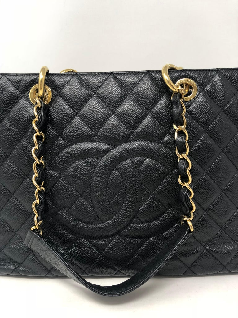 Chanel Black Grand Shopper Tote with gold hardware. Caviar leather in good condition. GST bags are discontinued at Chanel.  Guaranteed authentic.