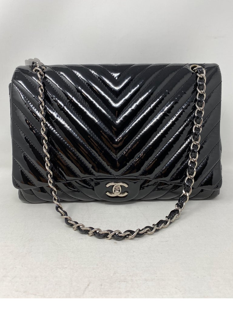 Chanel Black Jumbo Patent Leather Bag. Silver hardware. Good condition. Can be worn doubled or as a crossbody. Single flap. Good condition. Serial number inside the bag. Guaranteed authentic.