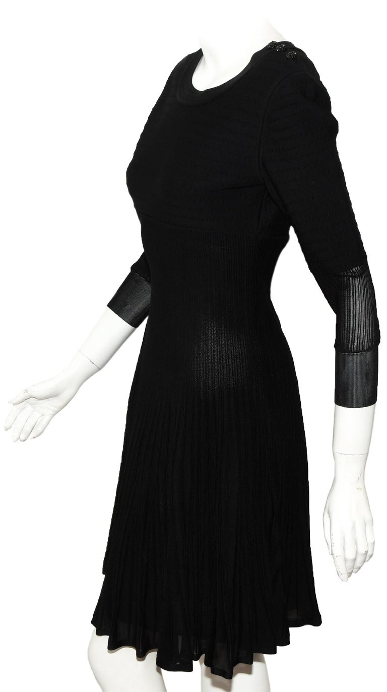 Chanel black knit silk blend dress from the 2009 cruise collection is a show stopper with stretch silk and viscose on the upper torso then transitioning to silk ribbed pleats and flaring to a full skirt.   The sleeves have the same composition as