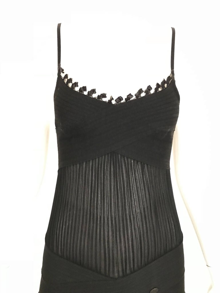 Sexy CHANEL spaghetti strap knit cocktail dress.   Excellent condition.  Fit size Small / 2 or 4 ( dress is stretchy) Measurement: Bust: 28' stretch up to 32