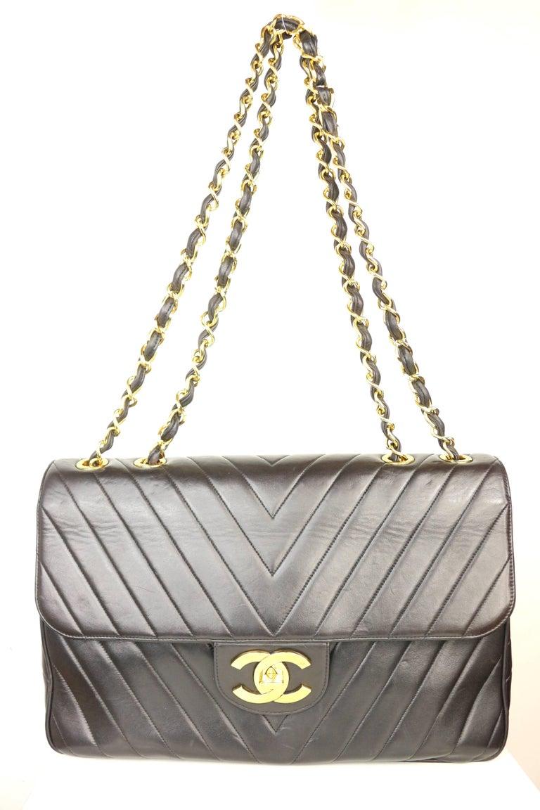 8320105a9468 Vintage 90s Chanel black lambskin chevron stitch maxi flap shoulder bag.  This bag is
