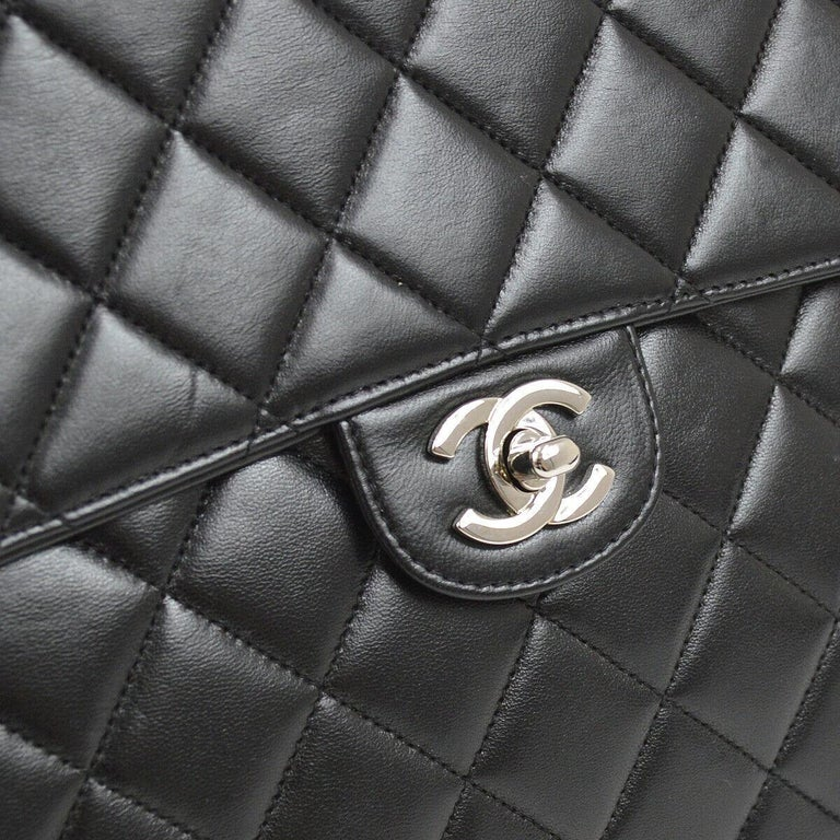 Chanel Black Lambskin Leather Silver Jumbo Evening Shoulder Flap Bag  Lambskin leather Silver tone hardware Turnlock closure Leather lining Date code present  Shoulder strap drop 24.5