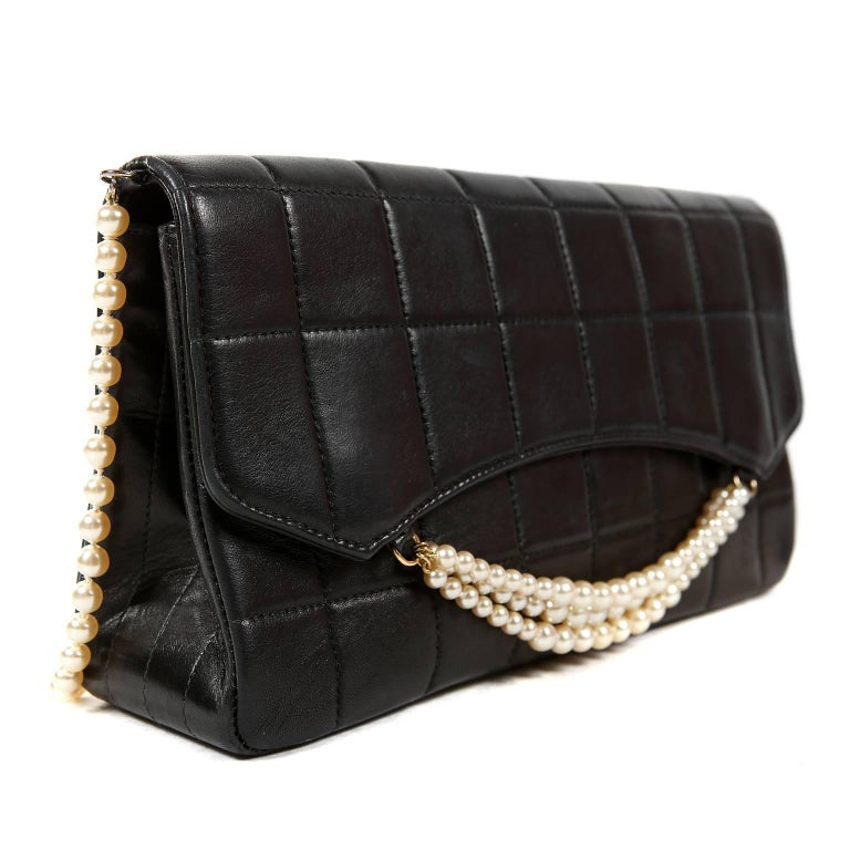 Chanel Black Leather and Pearl Bag In Excellent Condition For Sale In Palm Beach, FL