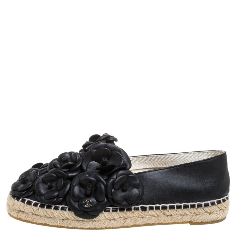 Espadrilles are not just stylish, but also comfortable and easy to wear. This lovely pair from Chanel will accompany a casual outfit with perfection. They are made of quality leather, carry a black hue, and are detailed with signature Camellia