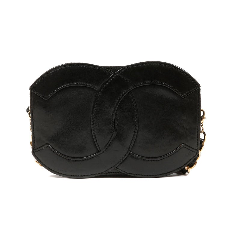 This authentic Chanel Black Leather CC Vintage Crossbody Bag is in very good condition.  It is a highly collectible vintage piece that has enjoyed a previous life.   Small black leather crossbody is shaped in interlocking CC silhouette.  Zippered
