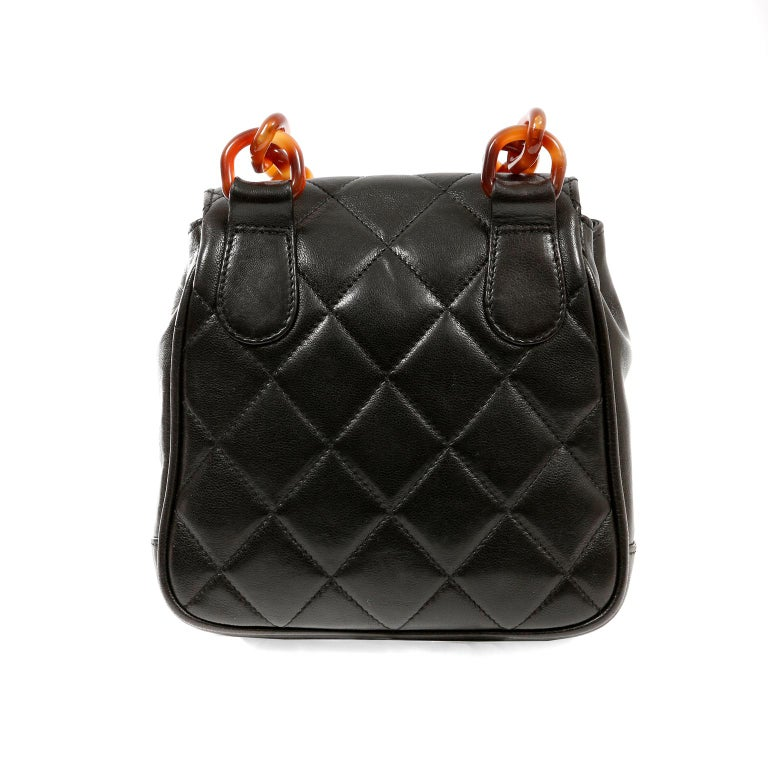 This authentic Chanel Black Leather Tortoise Chain Crossbody Bag is in beautiful vintage condition.  It has enjoyed a previous life and may have some small imperfections. The resin tortoise details makes this a highly collectible piece.  Black