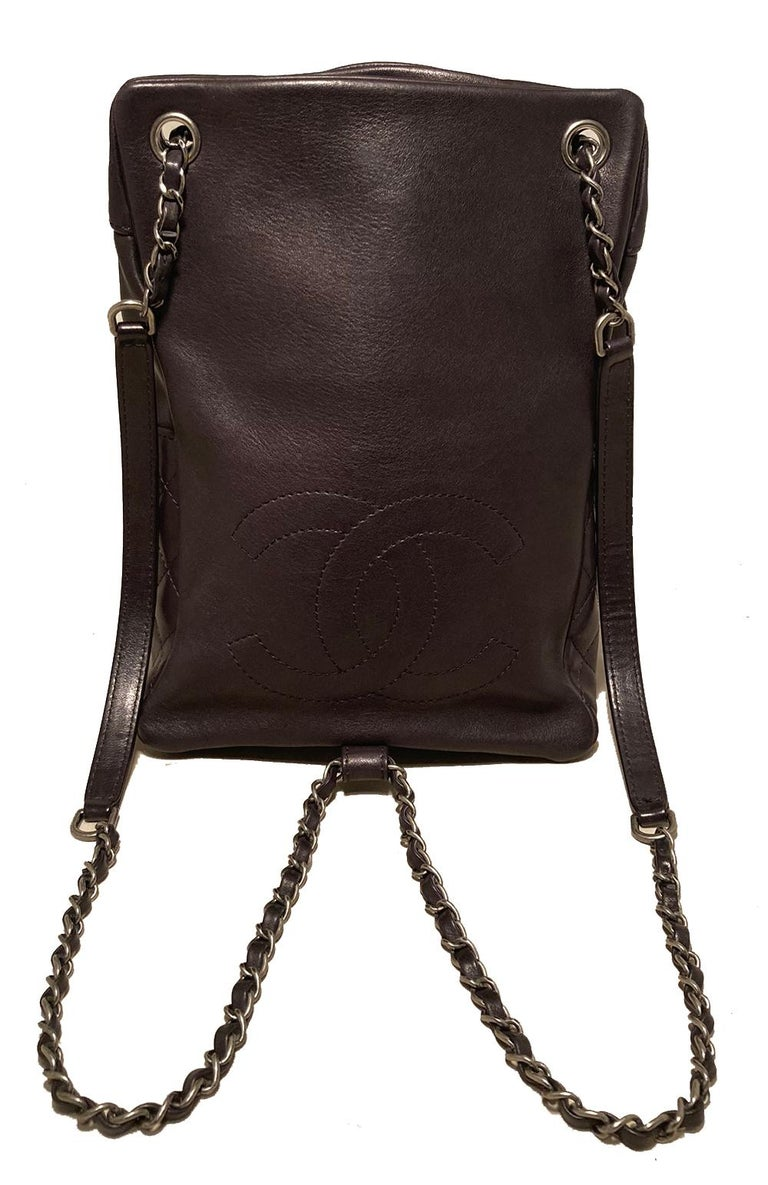 Chanel Black Leather Backpack in excellent condition. Black leather exterior trimmed with antiqued silver hardware and signature diamond quilted leather along half of front and sides. Smooth back exterior with CC logo quilted. Woven leather and
