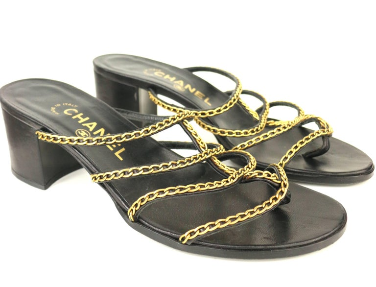 1d16a9f8b20d Vintage 90s Chanel black leather gold chain sandals with heels. - Open toes.