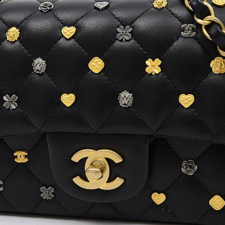 Chanel Black Leather Gold Gunmetal Charms Evening Shoulder Flap Bag  Leather Gold and gunmetal hardware Turnlock closure Leather lining Made in France Date code present Measures 7.5