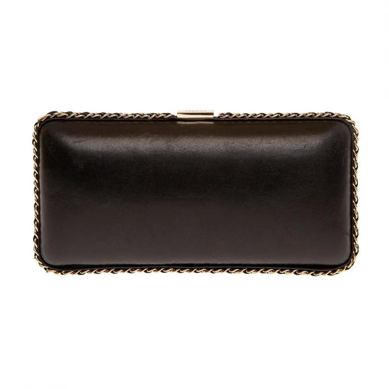 Chanel black leather gold hardware clutch - shoulder bag Limited edition clutch by Chanel embellished with gold tone harware and a shoulder strap inside so to be worn as a shoulder bag too. Signs of use  Measurements: widht: 22 cm heigh: 11