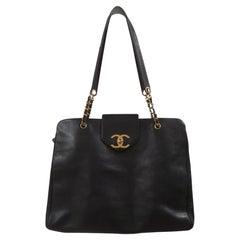 Chanel black leather gold hardware maxi shopping bag