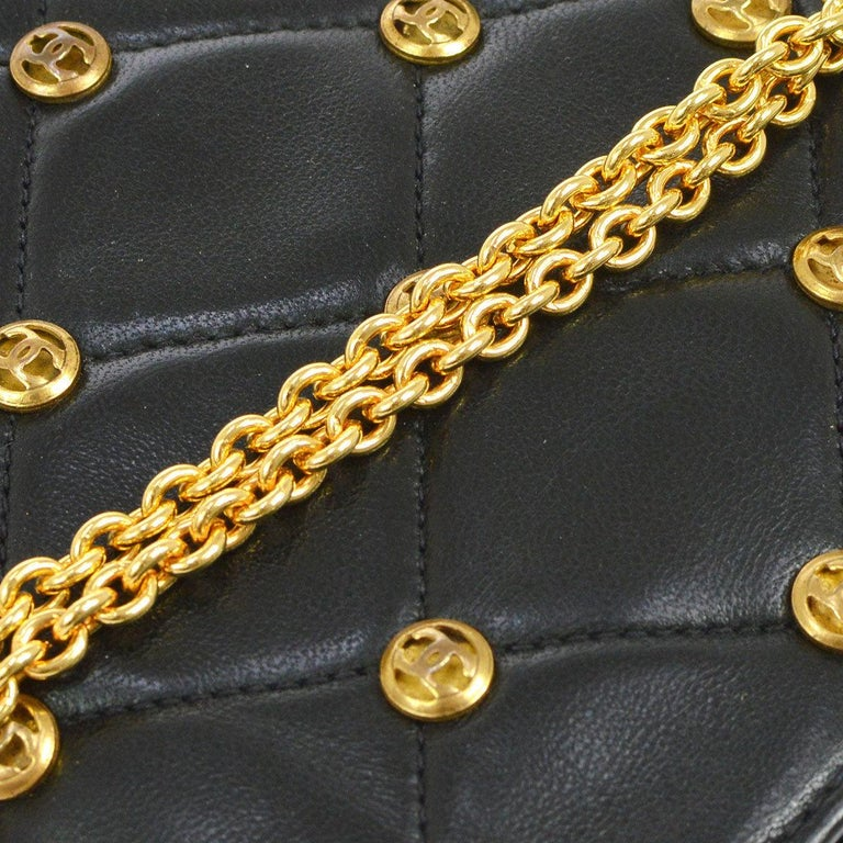 Chanel Black Leather Gold Logo Coin Clutch Evening Small Party Shoulder Flap Bag  Lambskin Gold tone hardware Leather lining Date code present Made in France Interior features built in mirror  Shoulder strap 20.5