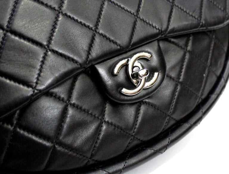 From the 2013 Spring collection there was this rare bag. Black quilted leather Chanel mini Hula Hoop bag with single interior zip pocket, structured top handles and front flap and CC turn-lock closure . Excellent condition for this unique and