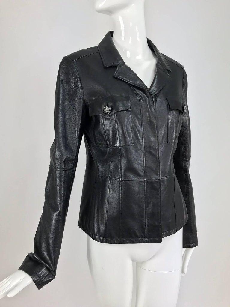 Chanel black leather jacket from 2007A...Buttery soft black leather with great seaming details, long sleeves, notched lapels, placket front with hidden rhinestone logo buttons...Two chest flap pockets with buttons...Fully lined in black silk...Looks