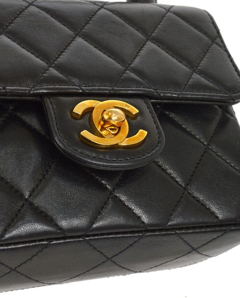 Chanel Black Leather Lambskin Small Mini Party Evening Top Handle Satchel Flap Bag  Lambskin Gold tone hardware Turn lock closure Leather lining Made in France Handle drop 3