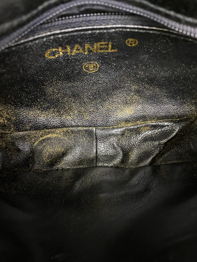 Chanel signature mini bag, made of black satin with golden hardware. Equipped with a magnetic button closure, internally lined in black leather, roomy for the essentials. Equipped with a leather and chain shoulder strap and an internal zip