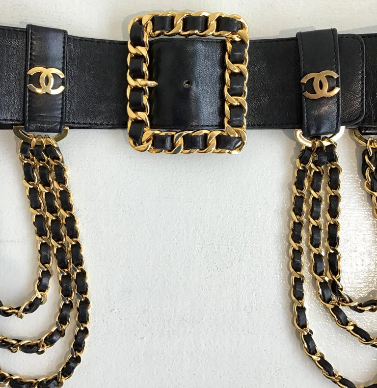 Chanel Black Wide Leather Multi Chain and Logo Belt. Featuring a gold toned chain link buckle at the front, Chanel logo on either side of buckle, including 3 chains on each side draped over the hips. Size 34.