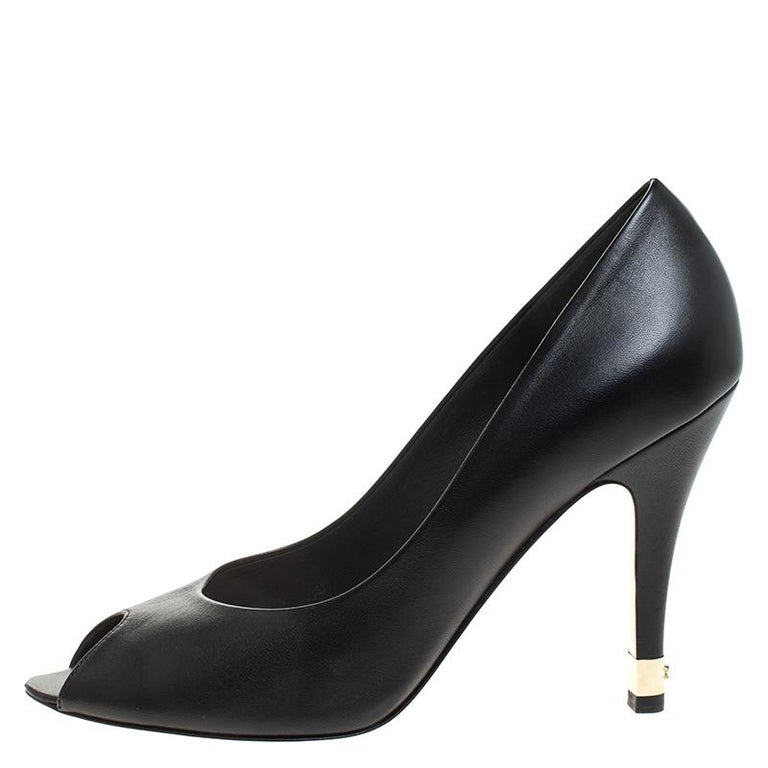 In a magical blend of luxury and elegance, these pumps come crafted from black leather and designed with peep toes and the CC-detailed metal inserts on the heels add the perfect finishing touch to the pair.  Includes: Original Box, Original Dustbag