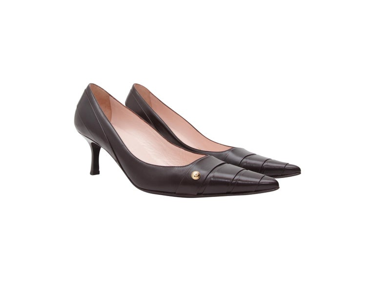 Product details:  Black leather kitten heels. by Chanel.  Straps accent vamp.  Point toe.  Slip-on style.  2