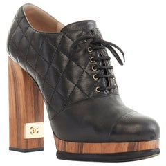 CHANEL black leather quilt stitched wooden platform CC chunky heel bootie EU39C