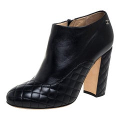 Chanel Black Leather quilted Zip Booties Size 37.5