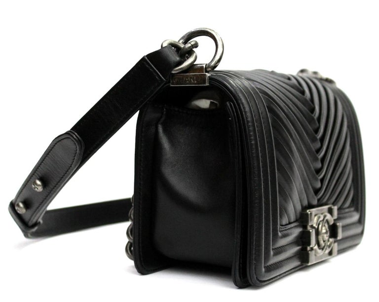 Beautiful Chanel Boy bag made of lambskin with chevron pattern. Black color with hardware silver. This is the smallest measure about