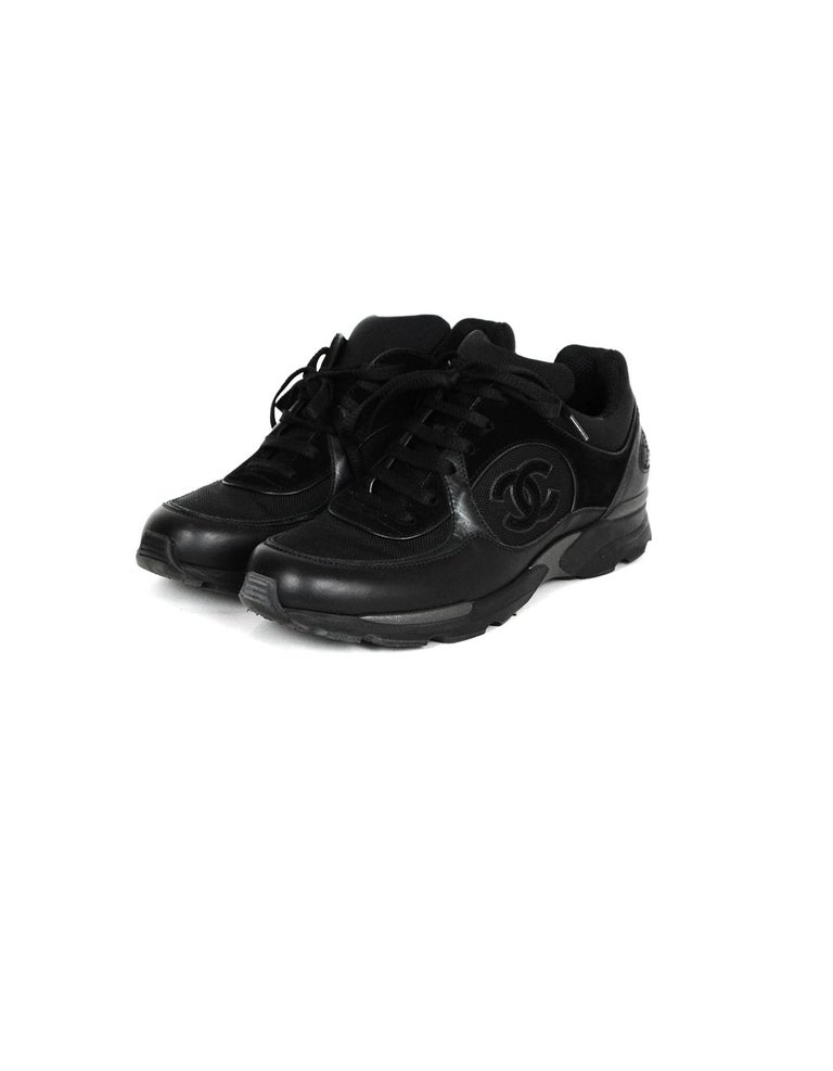 Chanel Black Leather/Suede Sneakers with CC Logo  Made In: Italy Color: Black Materials: Leather, suede Closure/Opening: Lace-up  Overall Condition: Excellent pre-owned condition, minor wear to soles Estimated Retail: $850 + tax Includes: