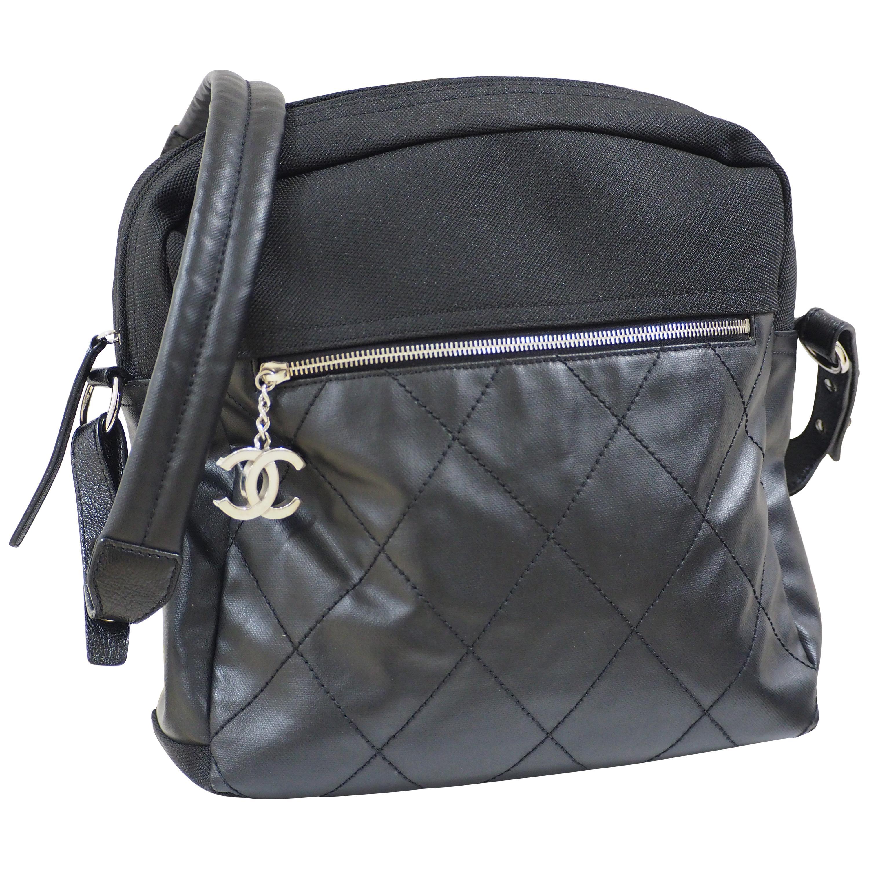 Chanel black leather textile shoulder bag / backpack