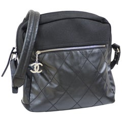 Chanel black leather textile shoulder bag / backpack