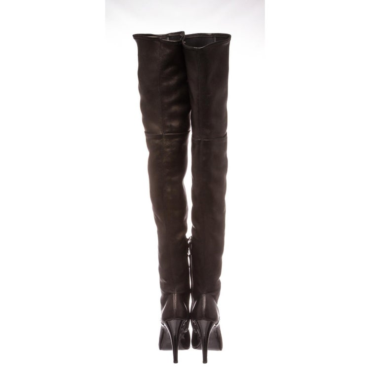 Black Chanel leather thigh-high boots with pearl accents at inner heels and round patent leather toe.  Designer Size 38.5.  23111MSC