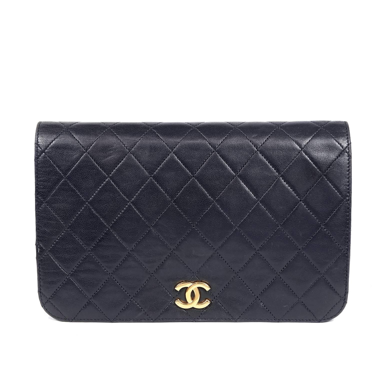 c6c3c42175de Chanel Black Leather Vintage Clutch with Strap at 1stdibs