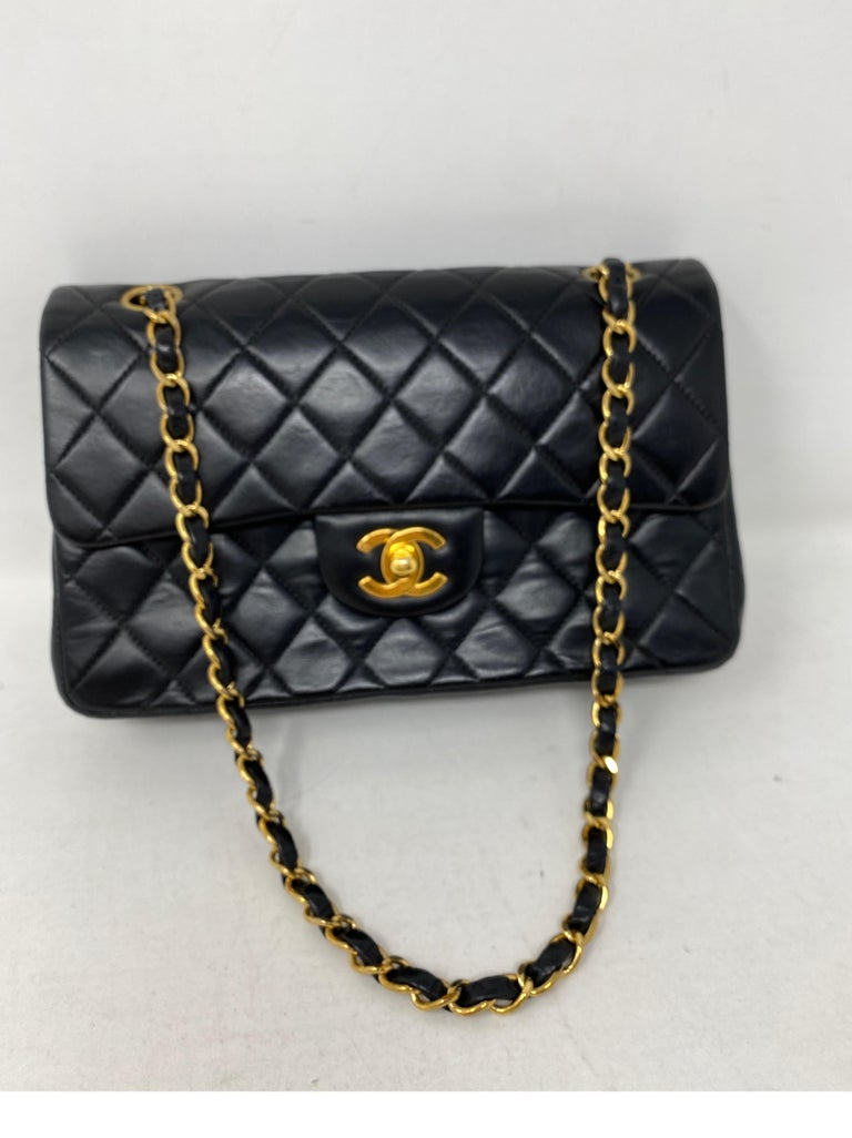 Chanel Black Lambskin Vintage Double Flap Bag. 24 kt gold plated hardware. Coveted vintage Chanel with burgundy color leather interior. Great condition for vintage. Hard to find 9
