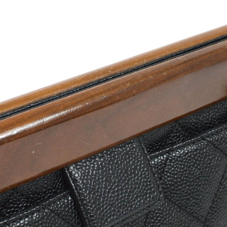 Caviar leather Wood Gold tone hardware Leather lining Snap closure Date code present Made in Italy Shoulder strap drop 7