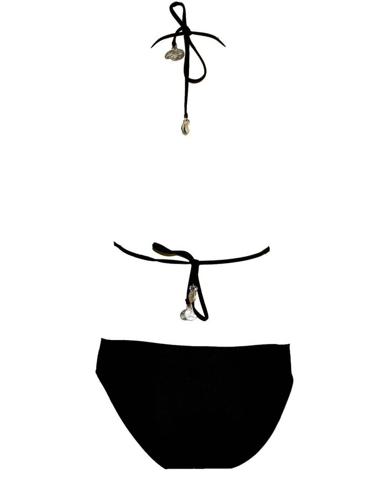 Classic CHANEL signature one-piece bodysuit     Can also be worn as swimsuit     Beautiful cut with open back Looks like bikini from back     Coin details on straps and in front of the cleavage     Coins embossed with various CHANEL NO5, COCO