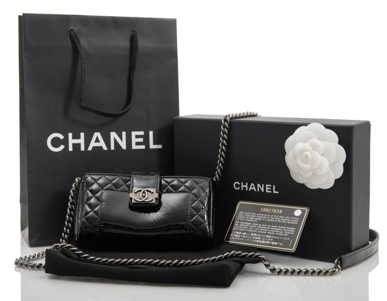 Chanel Black Patent Boy Reverso Quilt Mini Pochette Crossbody Bag.  Can be used as a mini evening bag to hold cards, cash, key, and lipstick. Fit for an iphone 6 / 7 is very tight. Original retail $1575.  Black patent leather body with dark