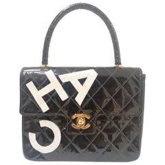 Chanel black patent leather handbag